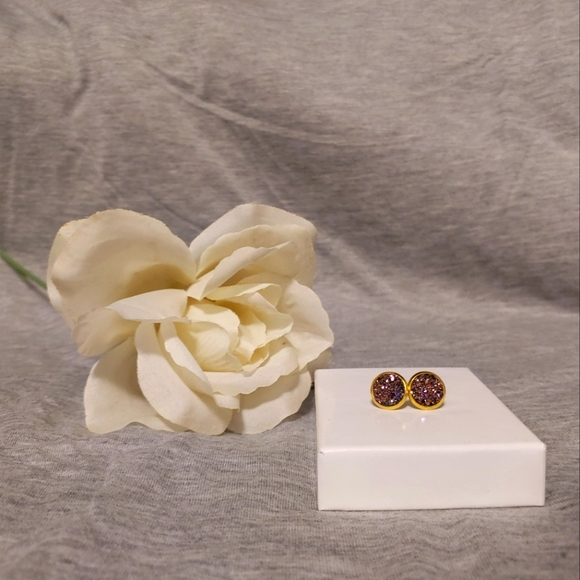 Gold and purple stud earrings